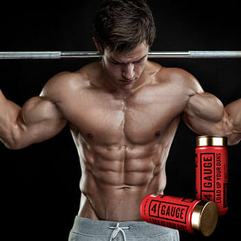 toned guy holding a bar