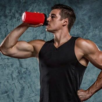 man drinking supplements