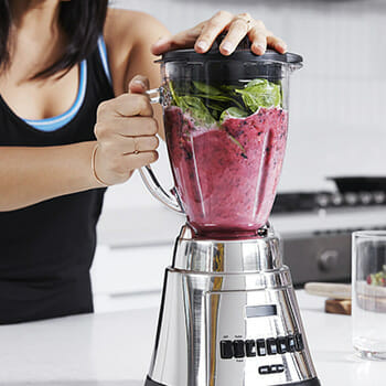 mixing ingredients in a proten shake