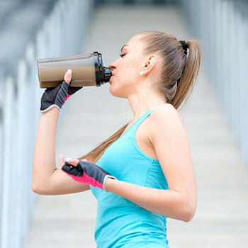Woman drinking from tumbler