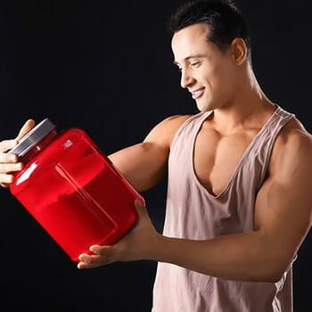 man holding a big jar