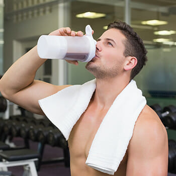man drinking mass gainer