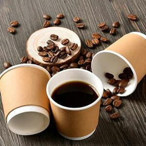 coffee beans and coffee in cup