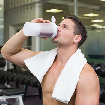 man drinking preworkout shake