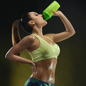 Woman drinking Recovery Shake