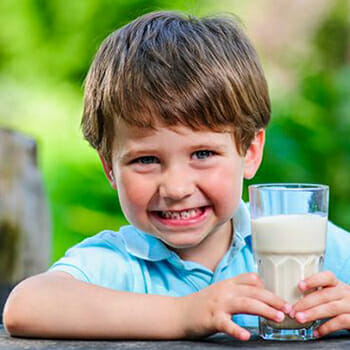 Boy holding Glass of Protein