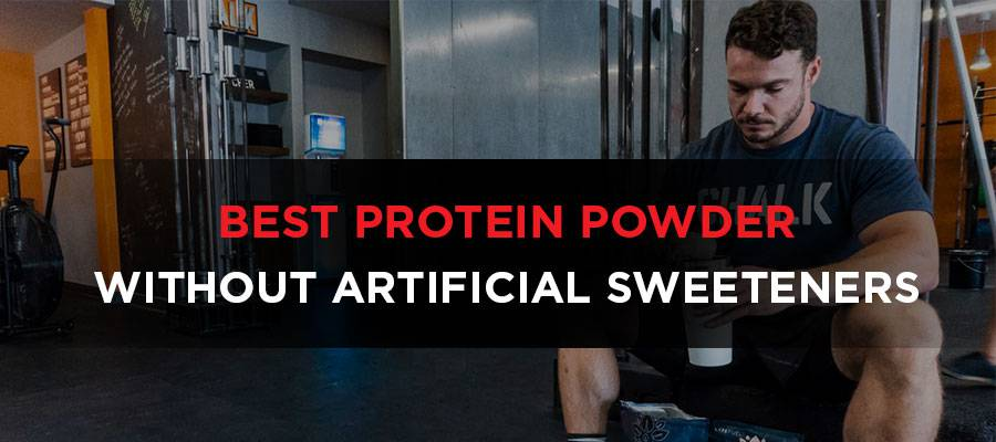 Bodybuilder sitting in gym with protein powder