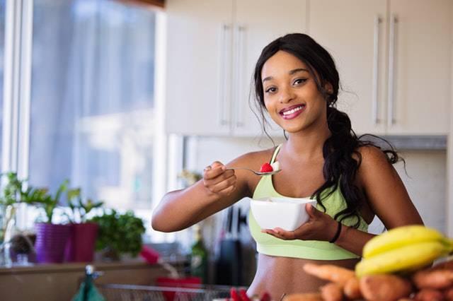 female bodybuilder eating