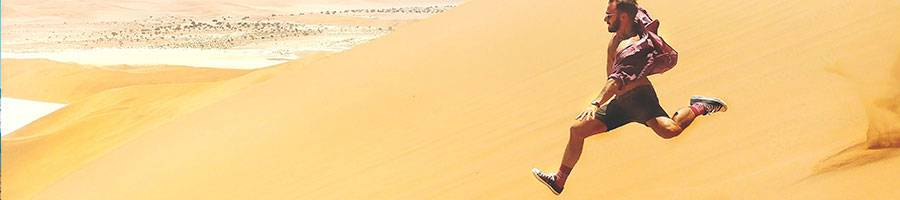 man running down on desert