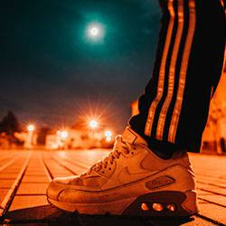 unpaired white Nike Airmax shoe