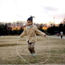 child skipping rope