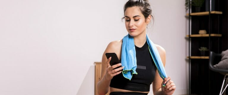 fitness-woman-using-mobile-phone