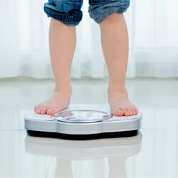 kid on weighing scale