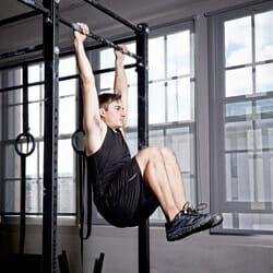man doing hanging knee races