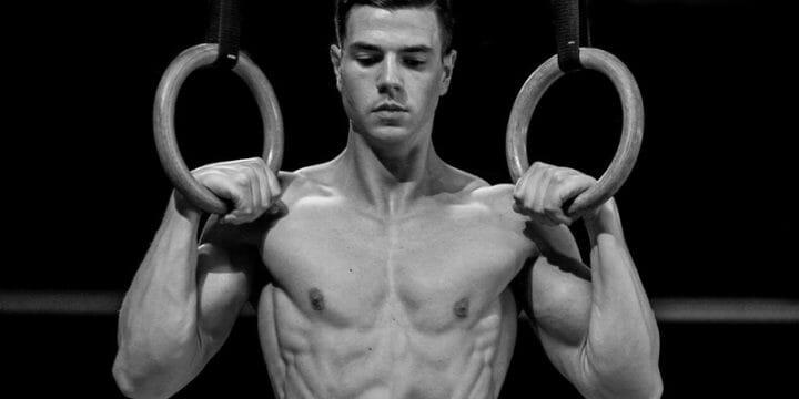 man using gymnastic rings