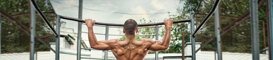 man using pullup bar