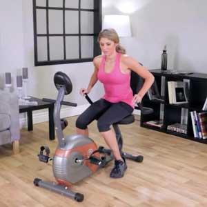fitness girl on recumbent bike