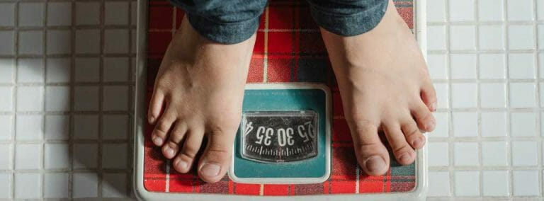 man weighing on scale