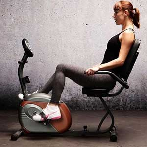 woman-with marcy recumbent bike