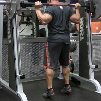standing calf raises in the gym
