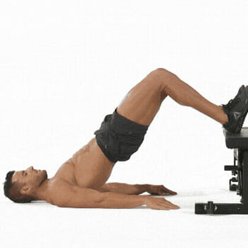 Man doing elevated hip thrusts