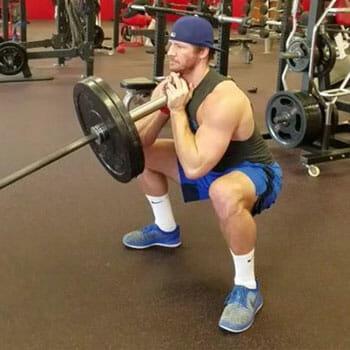 man doing a landmine front squats