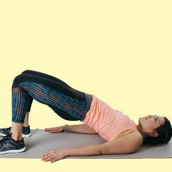 woman in a hip bridge position