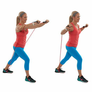 female doing an incline press with resistance band