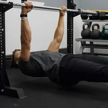 man doing inverted rows