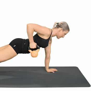 Woman doing a Kettlebell Plank