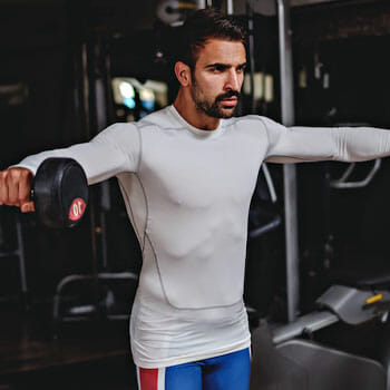 man doing lateral raise with a dumbbell