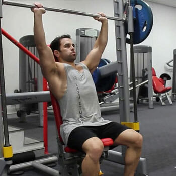 seated overhead shoulder press using a smith machine