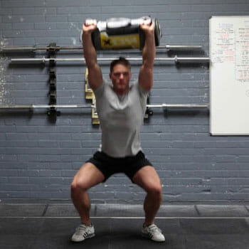 snatch exercise with a sandbag