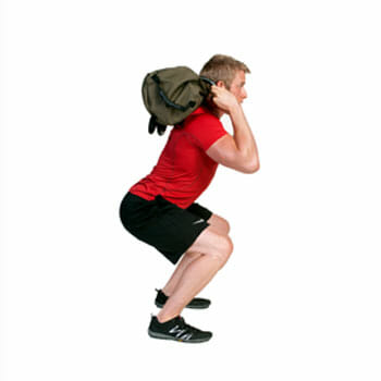 using sandbag to squat