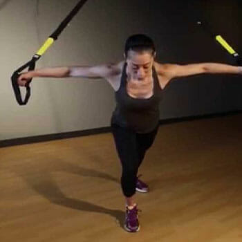woman doing TRX Chest Fly