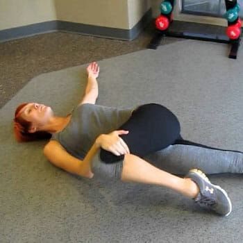 woman in a torso rotation stretch position