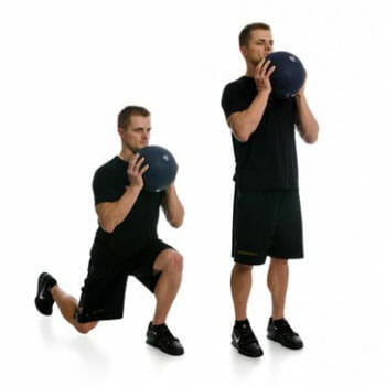 man doing overhead lunges with slamball