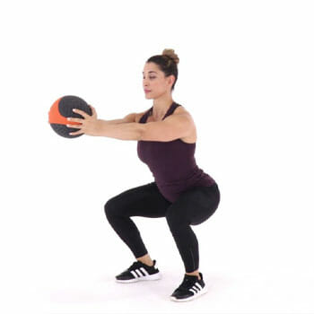 lady doing slamball squats