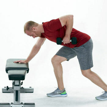 man doing a standing dumbbell row