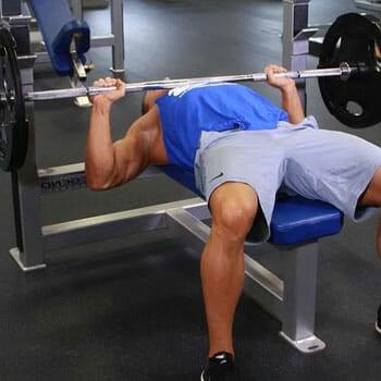 man doing barbell bench press