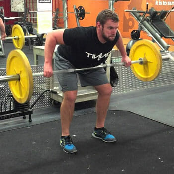 man doing barbell bent over rows