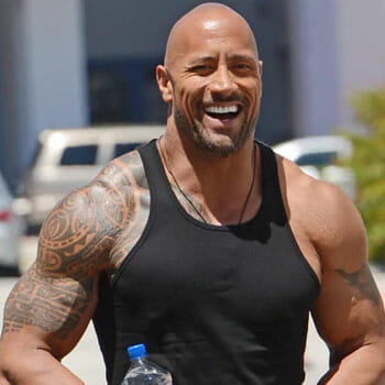 the rock wearing a blank tank top outdoors