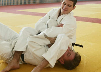 mwn doing judo grappling technique