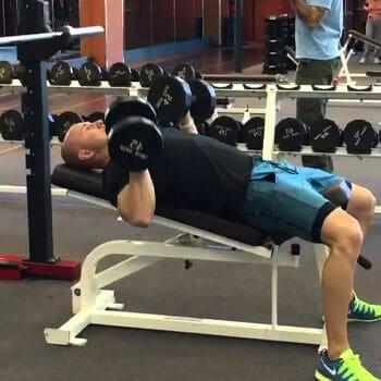 man doing Incline Dumbbell Bench Press