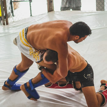 men fighting in a ring