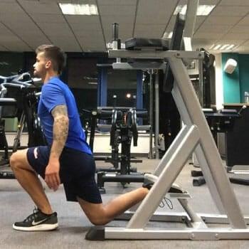 man doing split squats