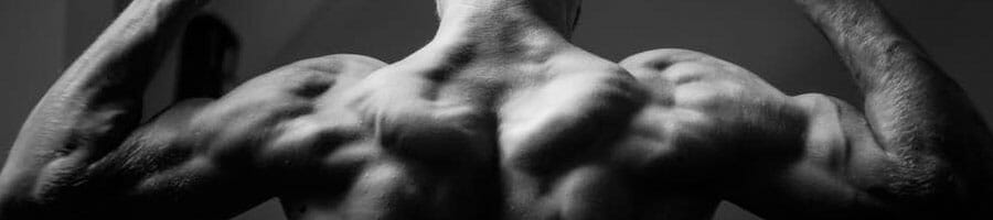 man flexing his back muscles