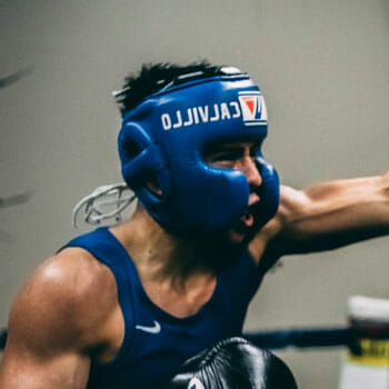 man boxing with a headgear