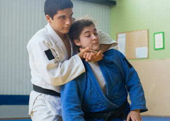 man and woman doing judo