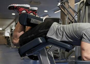 man in a leg curl position